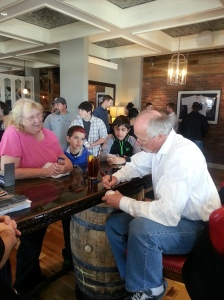 """Hall of Fame pitcher Rich """"Goose"""" Gossage signs autographs for fans at Bourbon Brothers on Sat. Feb. 8, 2014."""